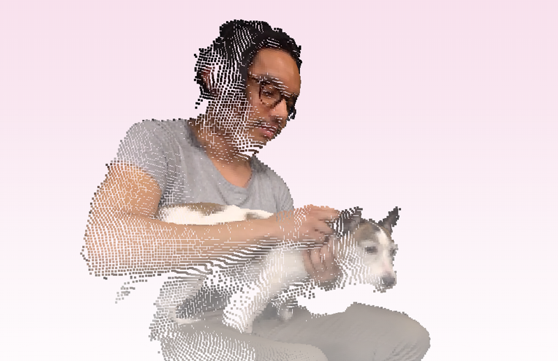 a person with shoulder length hair and glasses holds a small shaggy dog, but they're holograms! And volumetric ones at that!